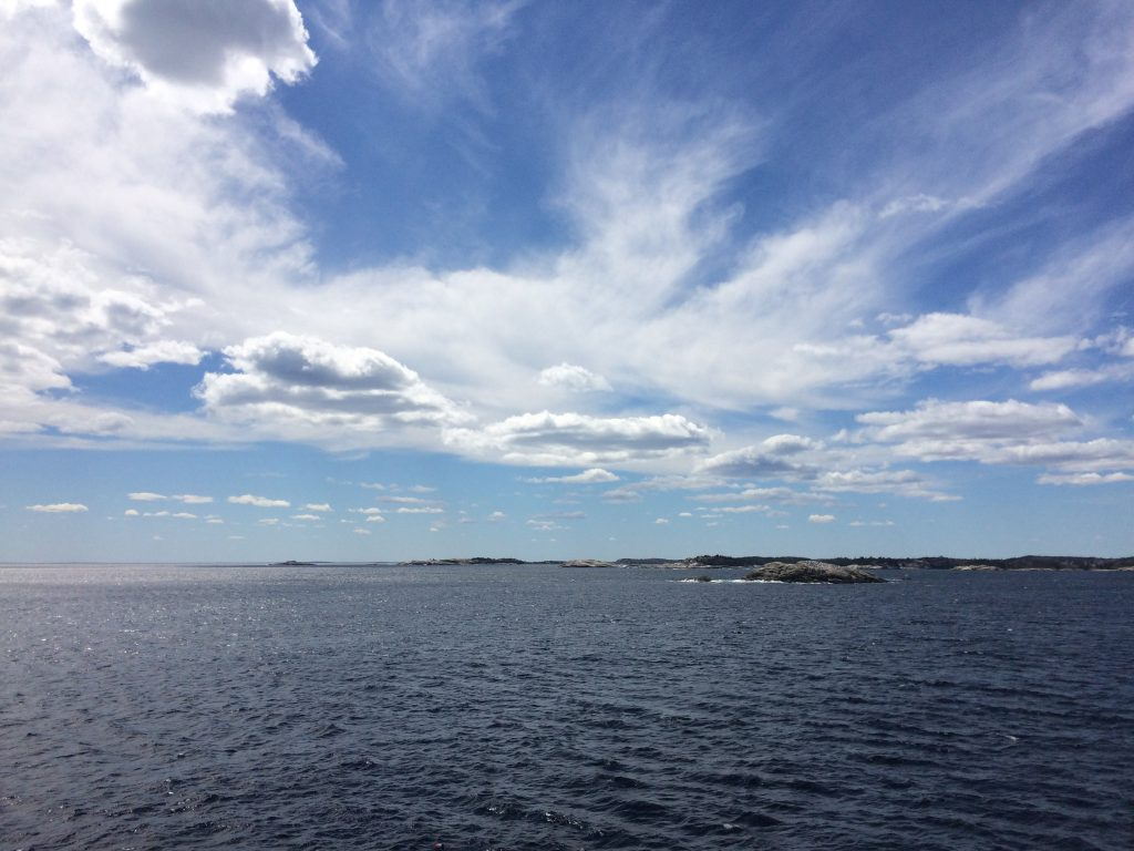 Gorgeous bright blue sky with sun rays and white clouds over the Atlantic Ocean. Prospect, Nova Scotia, Canada. Photo Credit: Sherri Simpson, iPhone 5S